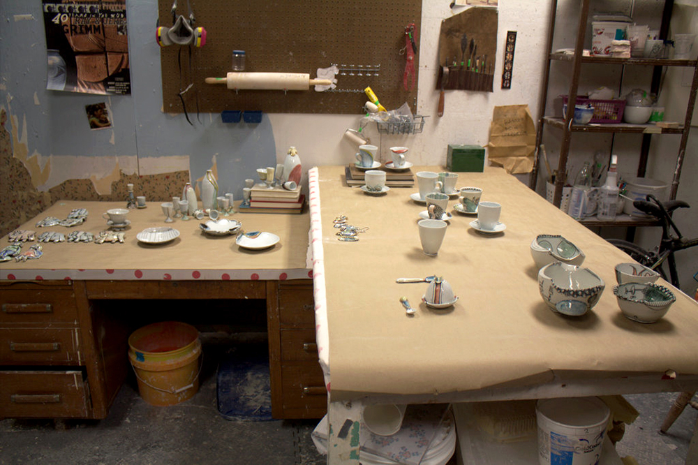 Ceramics bowls and cups on table.
