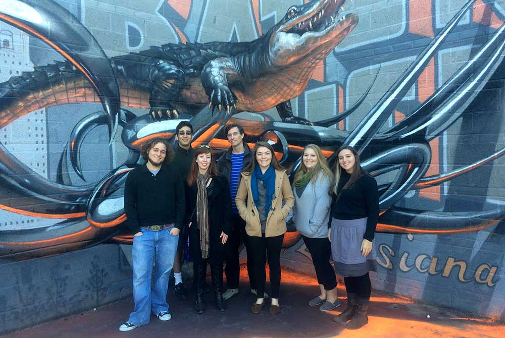 students by mural of alligator