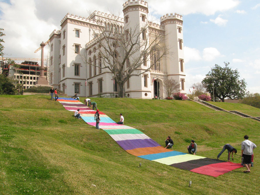 Colorful banner on hill by Louisiana Old State Capital