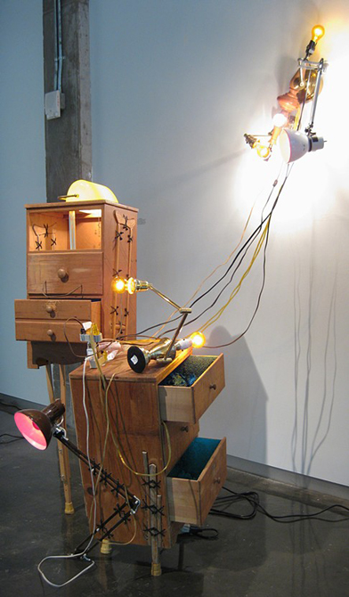 Wooden drawers open, lamps with cords. Cody Arnall LSU MFA Thesis
