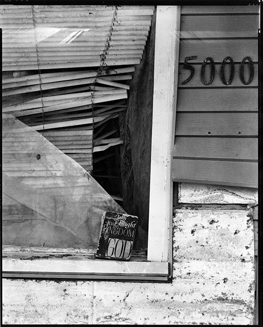 Old broken window with destroyed blinds