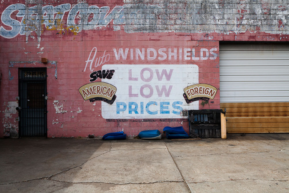 Old painted sings advertising new windshields