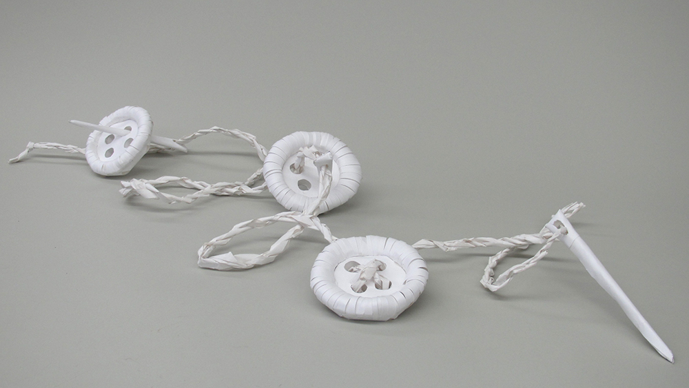 Paper buttons, needle and thread. LSU BFA Studio Art Foundations