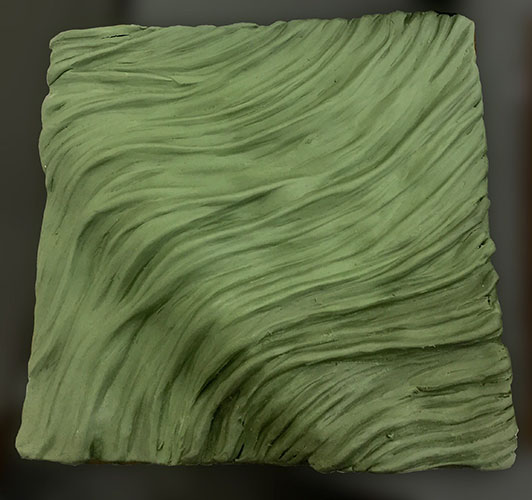 Clay study model of wavy land form surface pattern