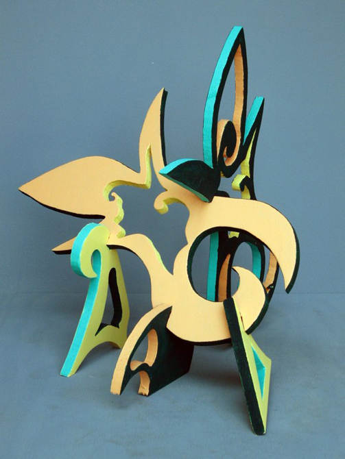 Puzzle sculpture with gree, peach, black panels. LSU BFA Studio Art Sculpture