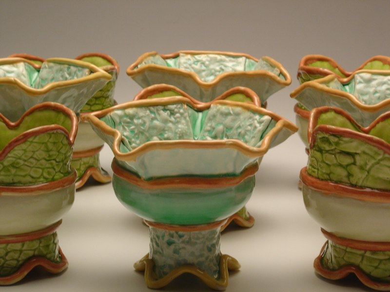 Pale green vessels with scale-like textures, LSU BFA Studio Art Ceramics