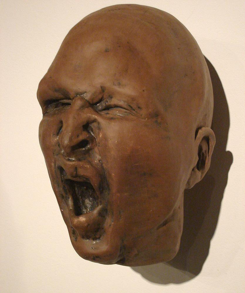 Yawning/sneering bald man, LSU BFA Studio Art Ceramics