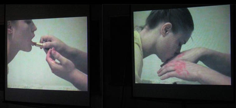 Screen showing young woman kissing hands with syringe. LSU BFA Studio Art Sculpture