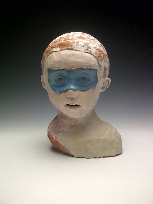 Bust of little boy with blue around eyes. LSU BFA Studio Art Ceramics