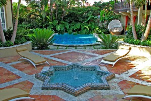 Star-shaped pool in lush courtyard, lsu landscape architecture alumni work