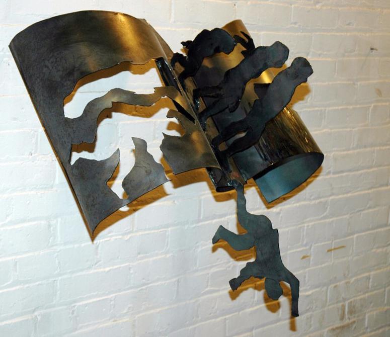 Book cutout with human figures; falling person. LSU BFA Studio Art Sculpture