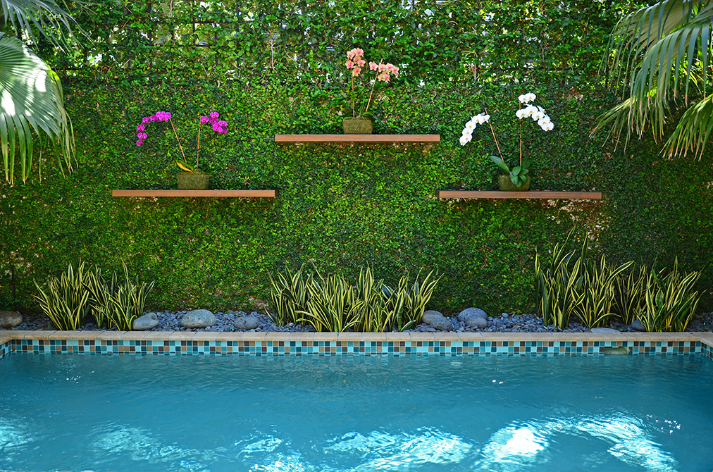 Pool and garden wall designed by Lewis Aqui , lsu landscape architecture alumni work