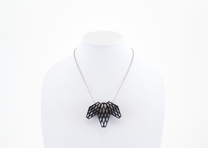 3D printed jewelry with black geometric design, lsu architecture alumni work