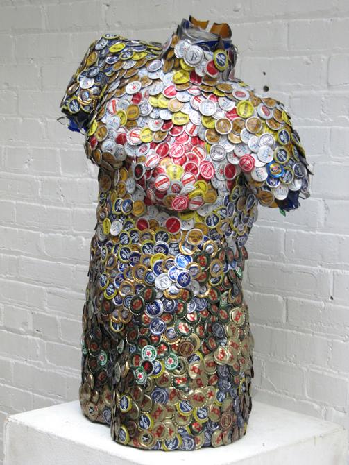 Human torso covered in beer bottle caps. LSU BFA Studio Art Sculpture