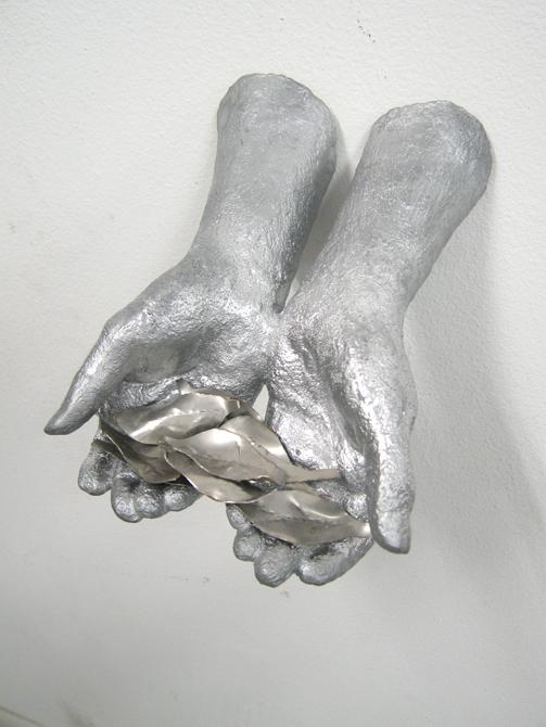 Silver hands holding leaves. LSU BFA Studio Art Sculpture