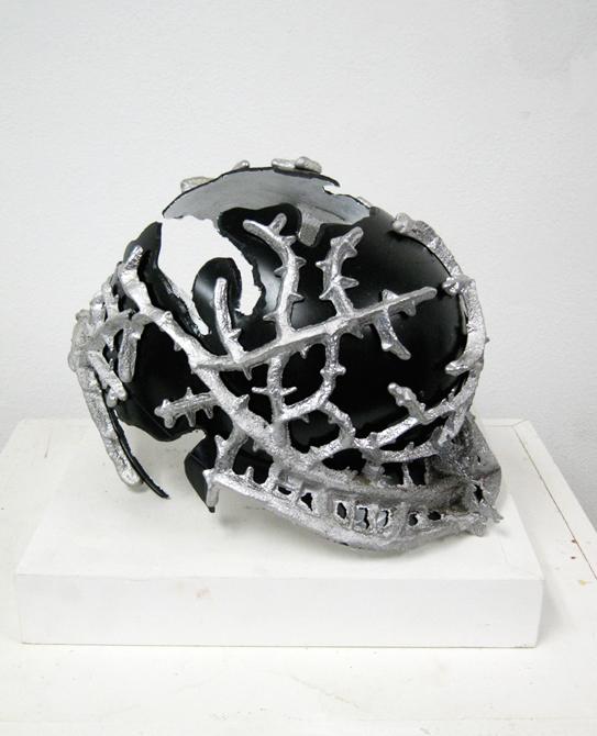 Silver thorns around black helmet. LSU BFA Studio Art Sculpture