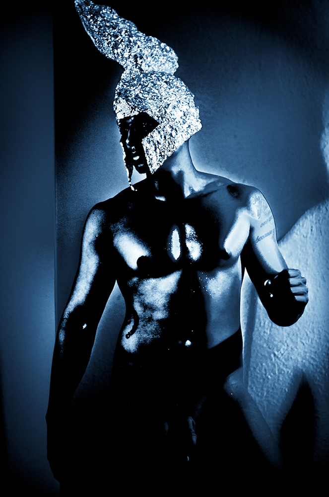 photo of nude man in gleaming body paint, tin foil helmet. LSU BFA Studio Art Photography
