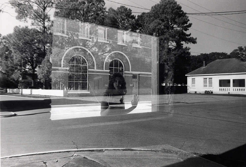 Reflection of woman in window