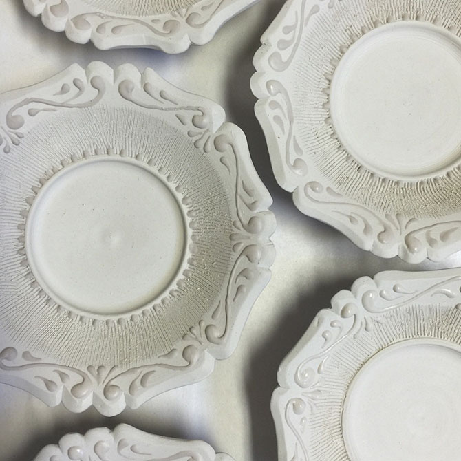 ornate white plates by mike stumbras