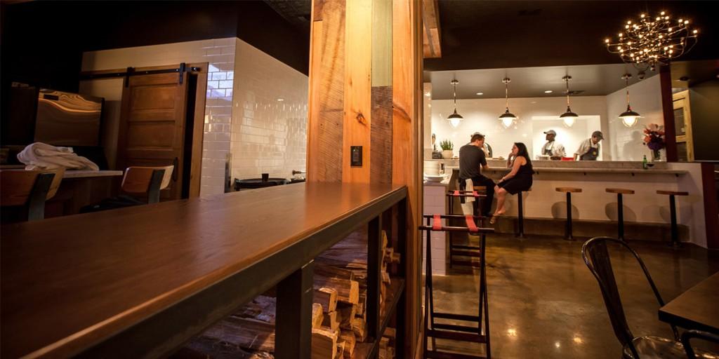 Modern bar area in restaurant, lsu architecture alumni work