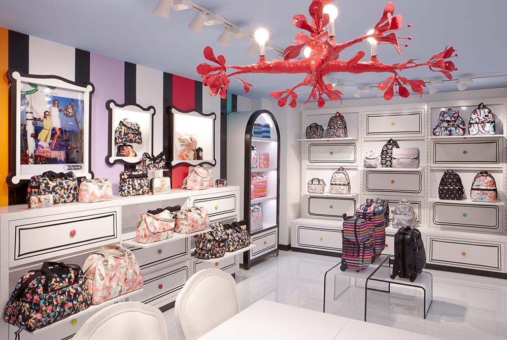 Trendy showroom with red light fixture; lsu interior design alumni work