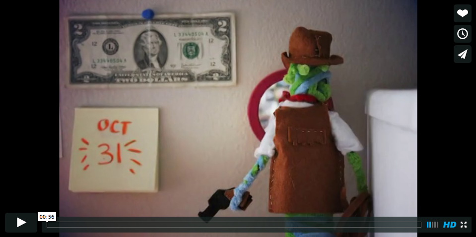 Still of Youtuve video of pipecleaner toy cowboy. LSU BFA MFA Studio Art Graphic Design