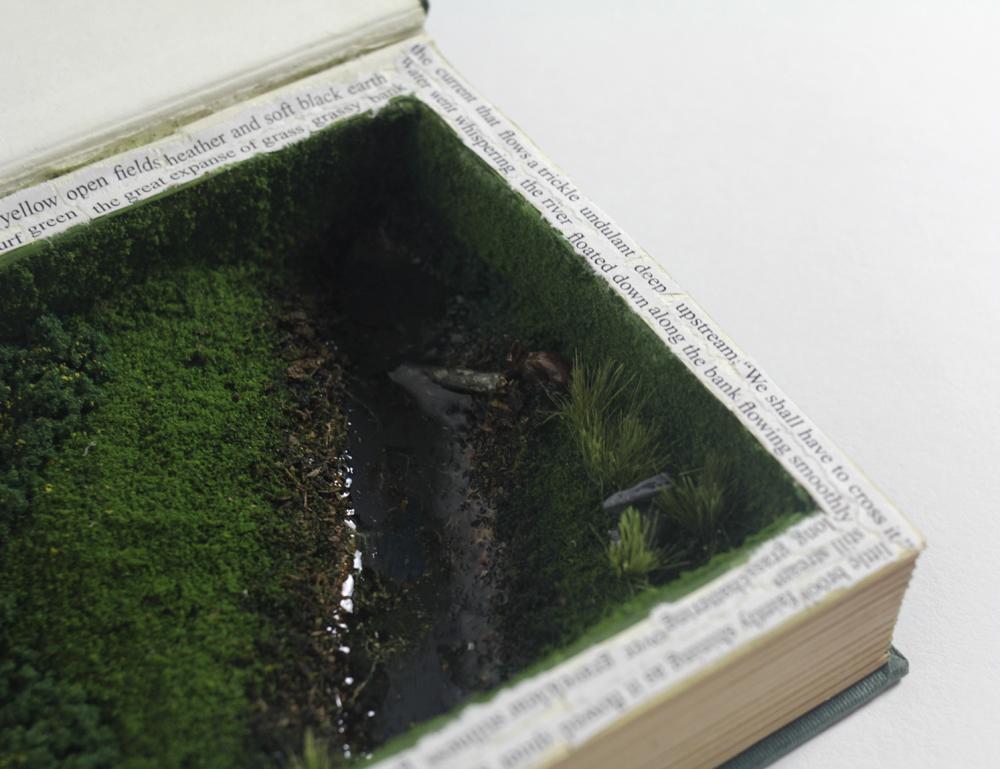 Close up of green moss, stream inside book. LSU BFA MFA Studio Art Printmaking Book Arts