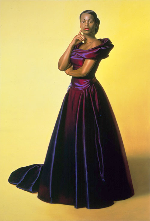 black woman in purple gown, yellow background
