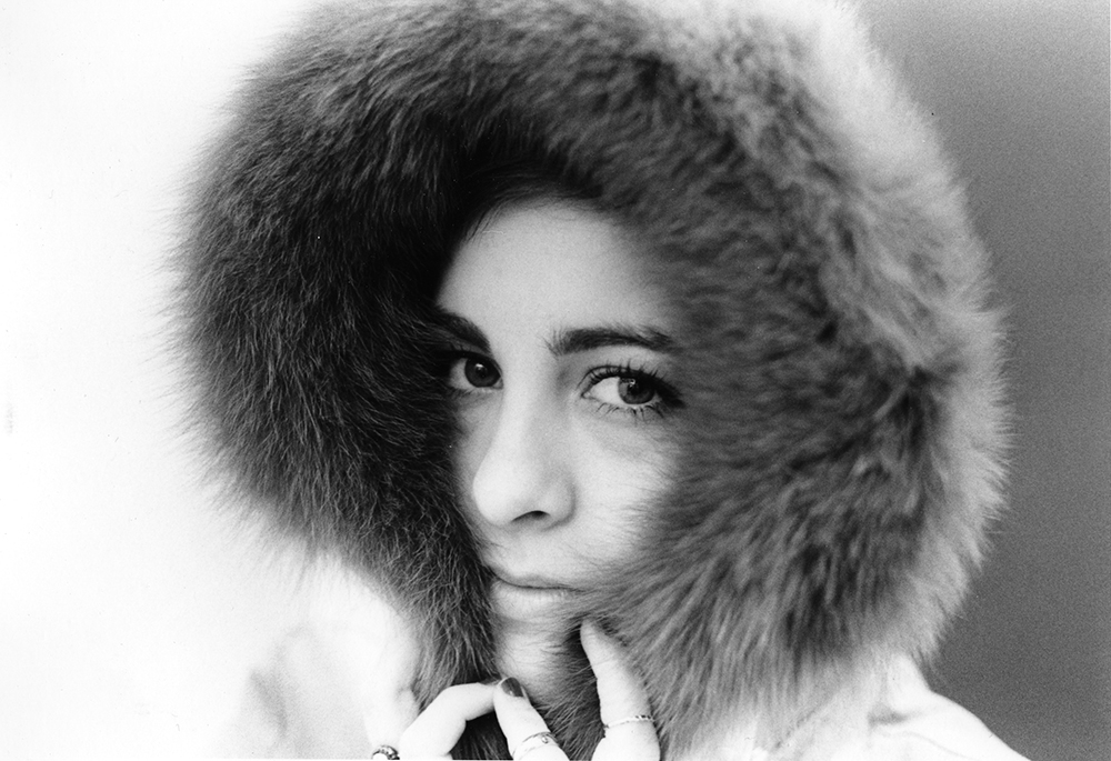 photograph of closeup of woman in fur hood