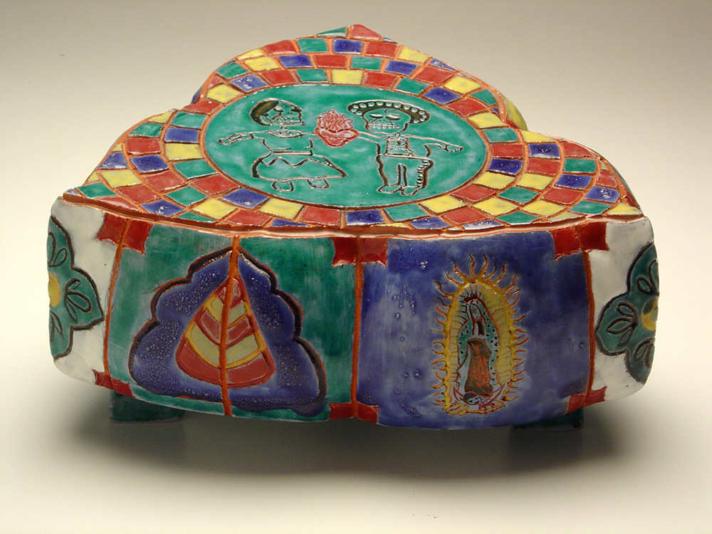Colorful ceramic with Day of the Dead figures, and tiles in red, blue, and yellow. LSU BFA Studio Art Ceramics