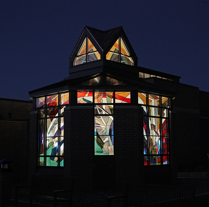 glowing stained glass windows at night