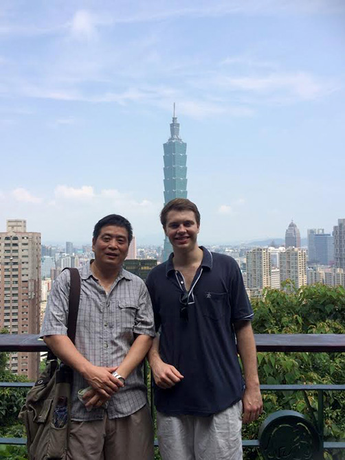 two men, city of Taipei in background