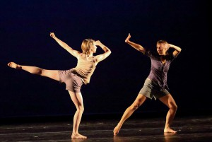 Photo of two students dancing on stage