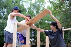 lsu architecture students work on constructing structure with wood