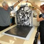 lsu school of art visiting artist making skull print on apron