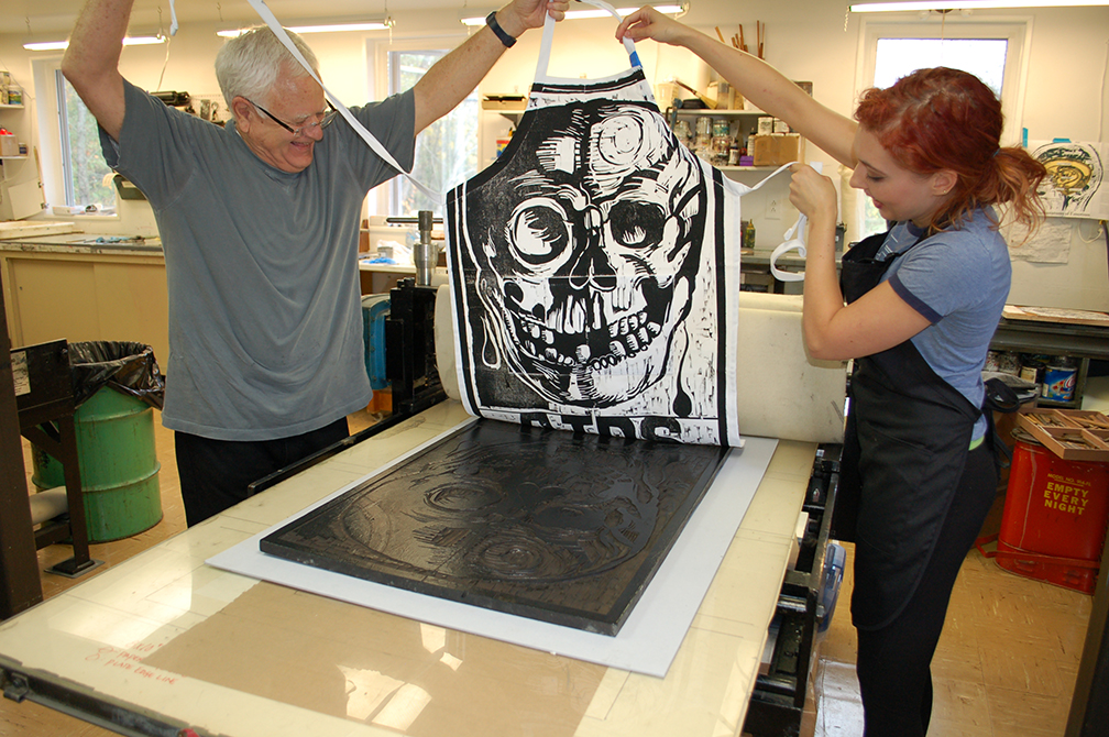 lsu school of art visiting artist making skull print on apron