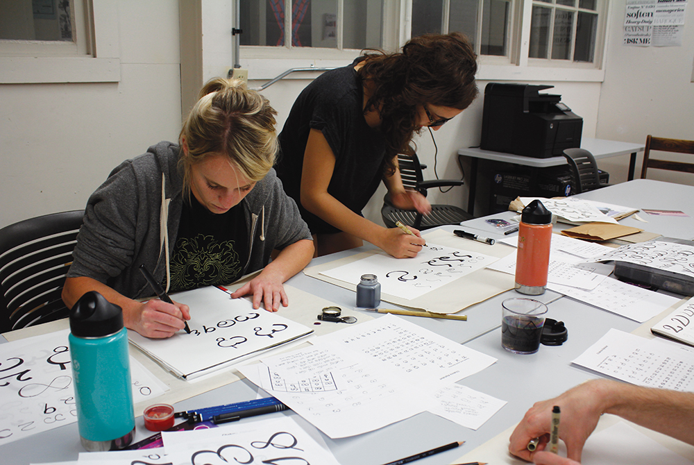lsu mfa candidates practicing lettering