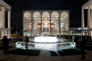 Lincoln Center Plaza scene: theater illuminated at night. LSU interior design alumni work by lighting designer Suzan Tillotson