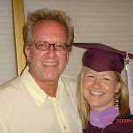 Ray Scott with young woman in graduation cap