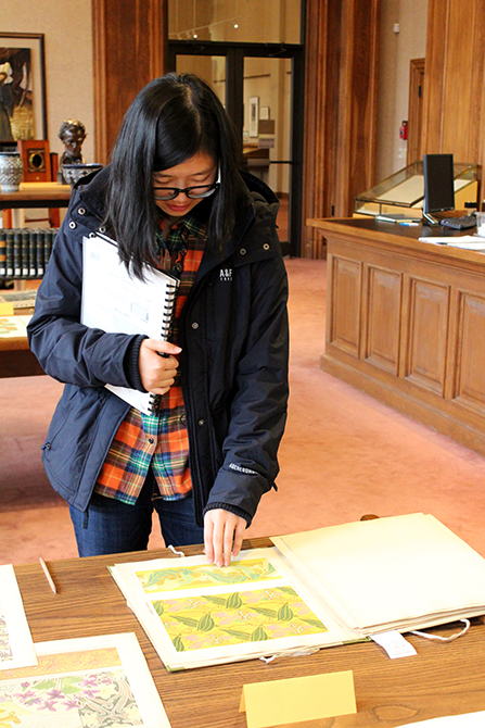 Student flipping through book in Hill Memorial Library