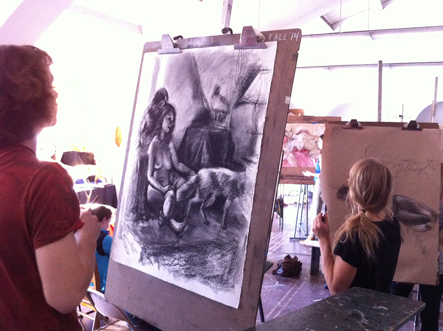 lsu art 4889 advanced figure drawing students work on charcoal drawings at easels