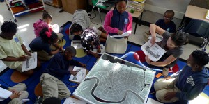Students working with elementary school children in a classroom