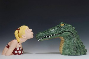 Ceramics sculptures of girl kissing an alligator