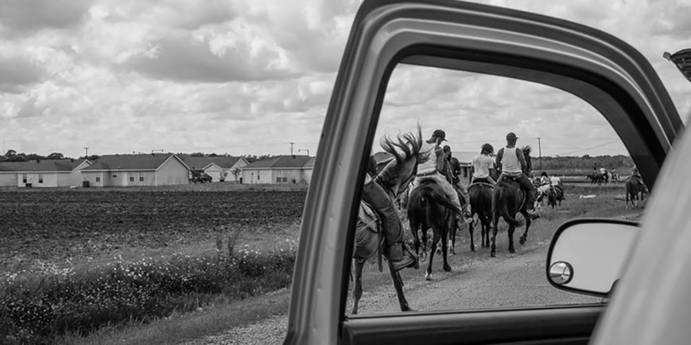 Photo of people riding horses by Jeremiah Ariaz