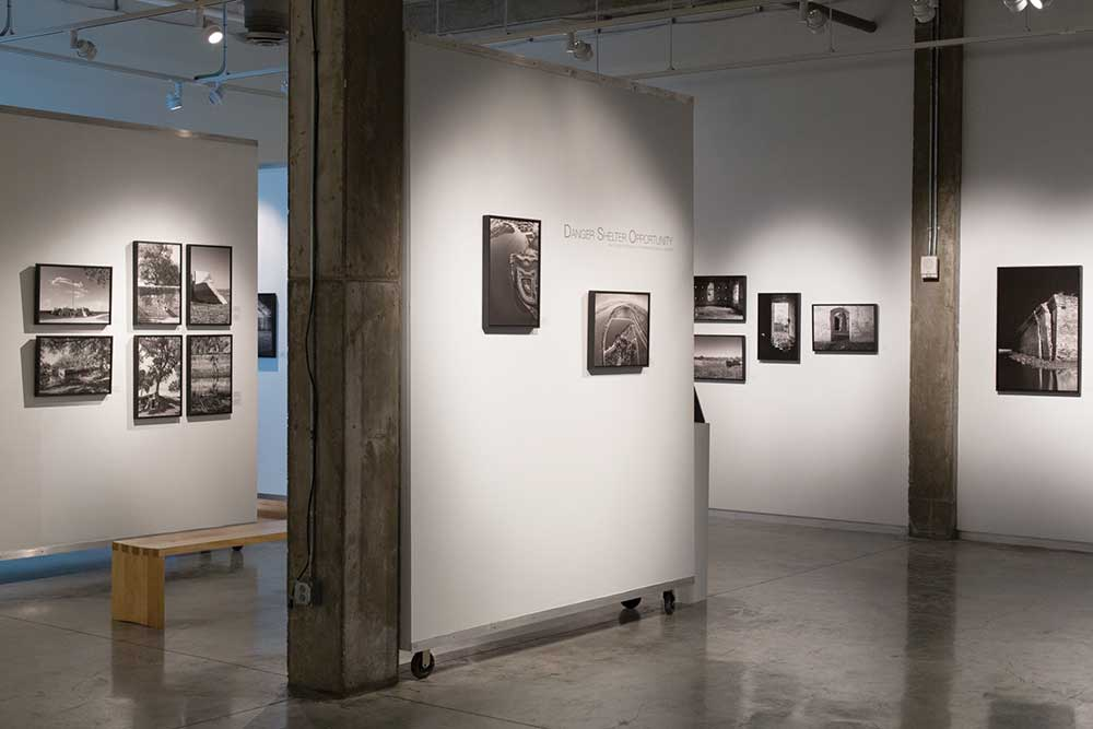 Gallery with photography on white walls
