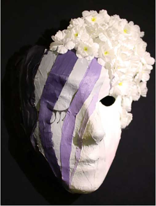 paper mache mask with purple stripes