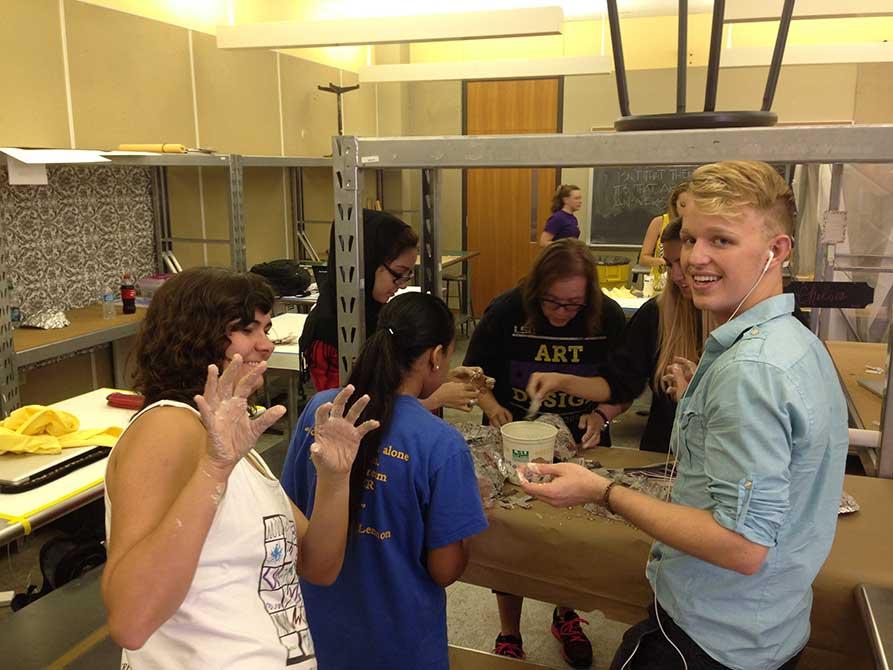 lsu interior design students work with plaster