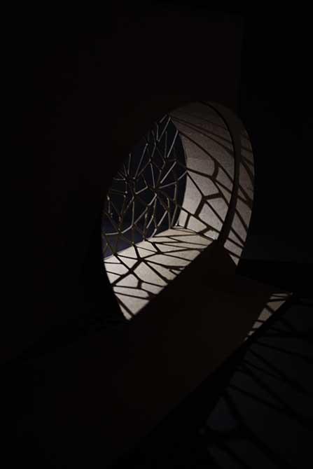 Model illuminated in black darkness, lsu interior design student work