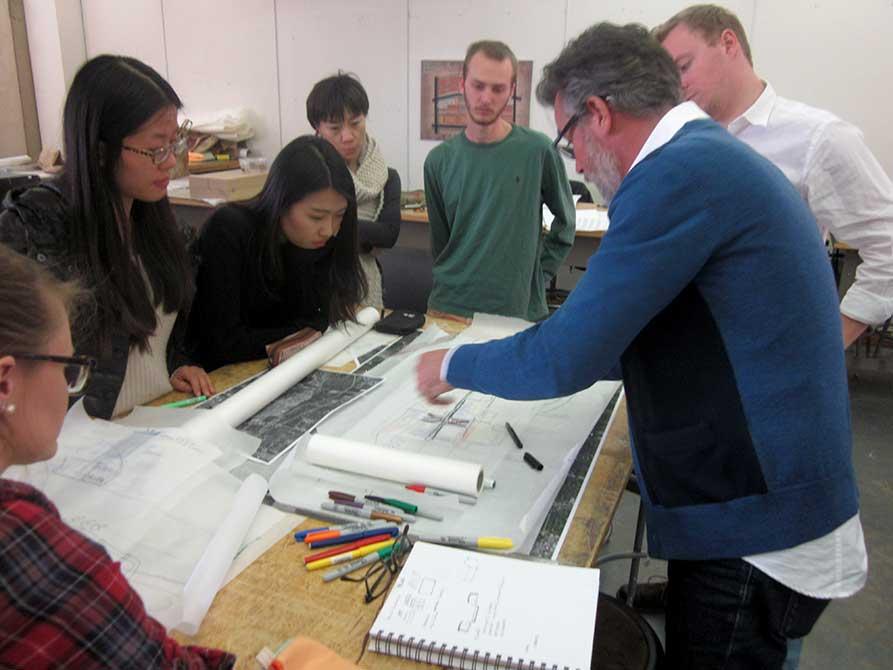 Kinder Baumgardner critiques one of the student teams participating in Design Week