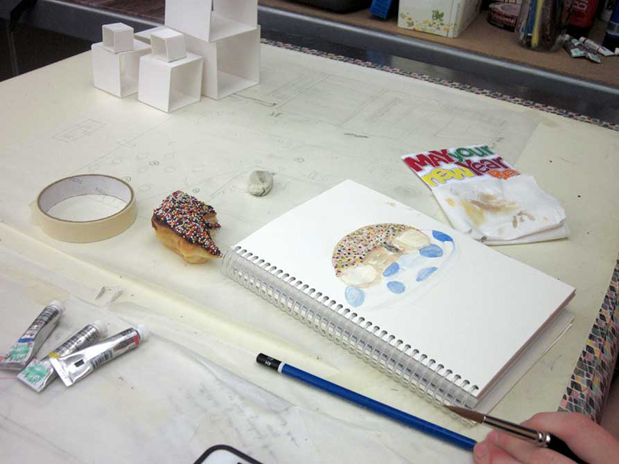 judi betts, Students sketch and paint donuts for practice in painting volume and form.